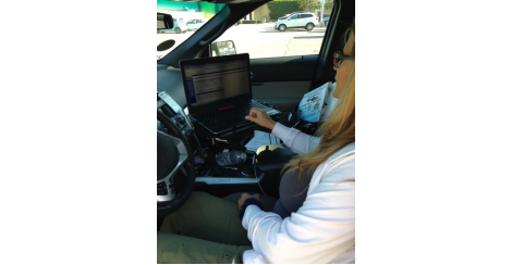 Woman using a laptop computer in a truck