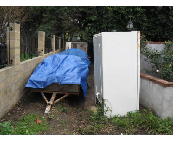 Discarded Appliances & Lawn Parking